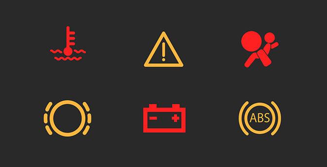Bilens varningslampor-vad betyder de?